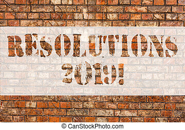 Word writing text Resolutions 2019. Business concept for promise yourself to do or to not doing something this year Brick Wall art like Graffiti motivational call written on the wall.