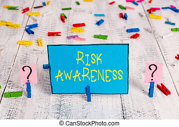 Word writing text Risk Awareness. Business concept for recognizing factors that may cause a lifethreatening effect Scribbled and crumbling sheet with paper clips placed on the wooden table.