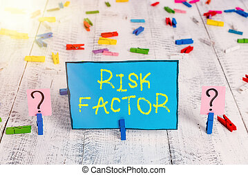 Word writing text Risk Factor. Business concept for Characteristic that may increase the percentage of acquiring a disease Scribbled and crumbling sheet with paper clips placed on the wooden table.