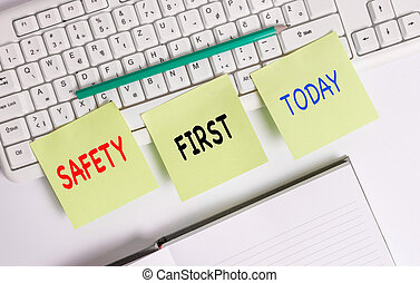 Word writing text Safety First. Business concept for used to say that the most important thing is to be safe Three empty green square papers by the pc keyboard with copy space.