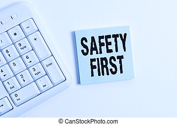 Word writing text Safety First. Business concept for used to say that the most important thing is to be safe White pc keyboard with empty note paper above white background.