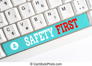 Word writing text Safety First. Business concept for used to say that the most important thing is to be safe White pc keyboard with empty note paper above white background key copy space.