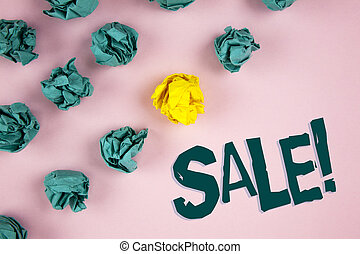 Word writing text Sale Motivational Call. Business concept for Selling goods at reduced prices Make a Sell written on plain Pink background Crumpled Paper Balls next to it.