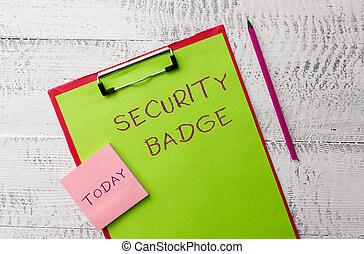 Word writing text Security Badge. Business concept for Credential used to gain accessed on the controlled area Metal clipboard paper sheets marker sticky notes pad wooden background.