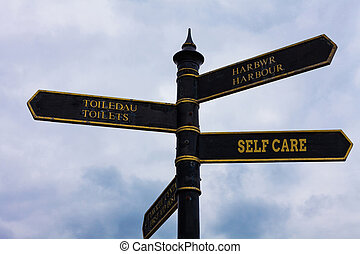 Word writing text Self Care. Business concept for the practice of taking action to improve one s is own health Road sign on the crossroads with blue cloudy sky in the background.