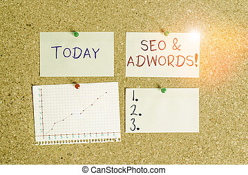 Word writing text Seo And Adwords. Business concept for they are main tools components of Search Engine Marketing Corkboard color size paper pin thumbtack tack sheet billboard notice board.