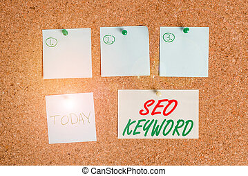 Word writing text Seo Keyword. Business concept for phrases in your web content that help showing find your site Corkboard color size paper pin thumbtack tack sheet billboard notice board.