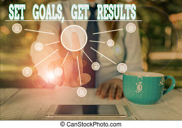 Word writing text Set Goals Get Results. Business concept for Establish objectives work for accomplish them Woman wear formal work suit presenting presentation using smart device.