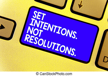 Word writing text Set Intentions. Not Resolutions.. Business concept for Positive choices for new start achieve goals Keyboard blue key Intention create computer computing reflection document.