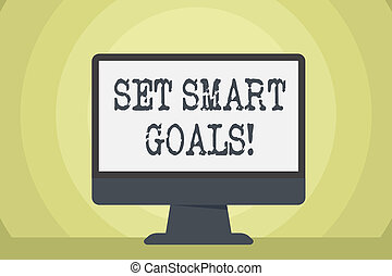 Word writing text Set Smart Goals. Business concept for list to clarify your ideas focus efforts use time wisely Blank Space Desktop Computer Colorful Monitor Screen Freestanding on Table.
