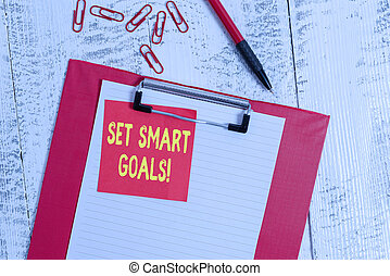 Word writing text Set Smart Goals. Business concept for list to clarify your ideas focus efforts use time wisely Clipboard paper sheet sticky note ballpoint clips vintage wooden background.