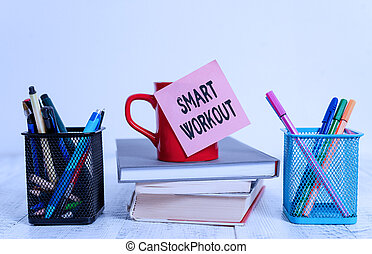 Word writing text Smart Workout. Business concept for set a goal that maps out exactly what need to do in being fit Coffee cup blank sticky note stacked books pen metal holders wooden table.