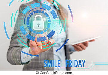 Word writing text Smile Friday. Business concept for used to express happiness from beginning of fresh week Female human wear formal work suit presenting presentation use smart device.