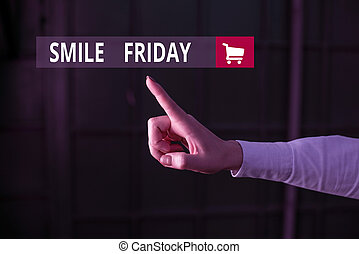 Word writing text Smile Friday. Business concept for used to express happiness from beginning of fresh week Finger pointing in the Dark with hand pointing in the copy space.