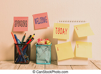 Word writing text Sponsors Welcome. Business concept for greet advertiser that supports a business or individual 6 Sticky Notes on Wall Open Spiral Notebook 2 Pencil Pots on Work Desk.