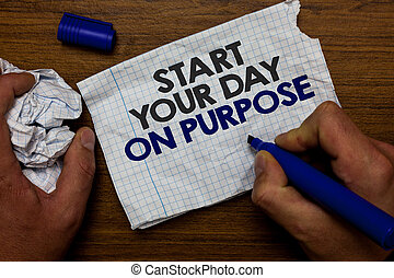Word writing text Start Your Day On Purpose. Business concept for Have clean ideas of what you are going to do Hand hold paper lob and blue marker wooden base with torn white written page.