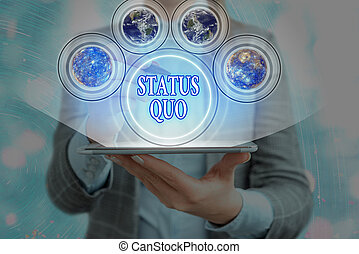 Word writing text Status Quo. Business concept for existing state of affairs regarding social or political issues Elements of this image furnished by NASA.