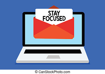 Word writing text Stay Focused. Business concept for Be attentive Concentrate Prioritize the task Avoid distractions Computer receiving email important message envelope with paper virtual