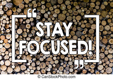 Word writing text Stay Focused. Business concept for Maintain Focus Inspirational Thinking Wooden background vintage wood wild message ideas intentions thoughts.