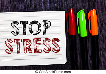 Word writing text Stop Stress. Business concept for Seek help Take medicines Spend time with loveones Get more sleep Notebook paper colorful markers wooden background communicating ideas.