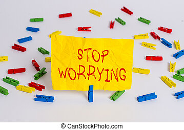 Word writing text Stop Worrying. Business photo showcasing stop thinking about something bad that happened in the past Colored clothespin papers empty reminder white floor background office