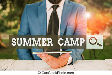 Word writing text Summer Camp. Business concept for supervised program for children conducted during the summer Businessman with mobile phone in his hand.