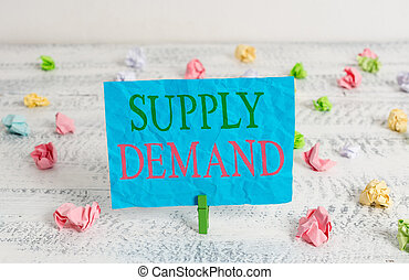 Word writing text Supply Deanalysisd. Business concept for Relationship between the amounts available and wanted Green clothespin white wood background colored paper reminder office supply.