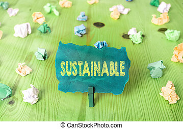 Word writing text Sustainable. Business photo showcasing the ability to be sustained, supported, upheld, or confirmed Colored crumpled rectangle shaped reminder paper light blue background