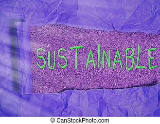 Word writing text Sustainable. Business photo showcasing the ability to be sustained, supported, upheld, or confirmed Rolled ripped torn cardboard placed above a wooden classic table backdrop