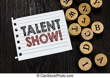 Word writing text Talent Show. Business concept for Competition of entertainers show casting their performances Piece notebook paper circle letters ideas inspiration wooden background.