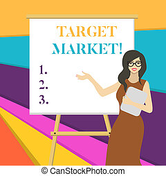 Word writing text Target Market. Business concept for Particular group of consumers which a product is aimed White Female in Glasses Standing by Blank Whiteboard on Stand Presentation.