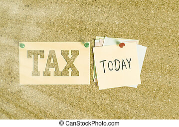 Word writing text Tax. Business concept for Compulsory contribution to state revenue Levy impose by government Corkboard color size paper pin thumbtack tack sheet billboard notice board.
