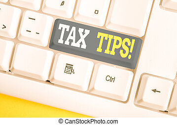 Word writing text Tax Tips. Business concept for compulsory contribution to state revenue levied by government White pc keyboard with empty note paper above white background key copy space.