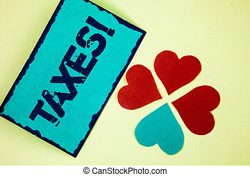 Word writing text Taxes Motivational Call. Business concept for Money demanded by a government for its support written on Sticky Note paper on plain background Paper Love Hearts next to it.