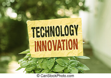 Word writing text Technology Innovation. Business concept for significant technological changes of products Plain empty paper attached to a stick and placed in the green leafy plants.