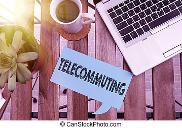 Word writing text Telecommuting. Business concept for work at home using an electronic linkup with central office Paper accesories with digital smartphone arranged on different background.