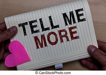 Word writing text Tell Me More. Business concept for A call to start a conversation Sharing more knowledge Man holding notebook paper heart Romantic ideas messages Wooden background.