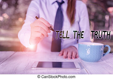 Word writing text Tell The Truth. Business photo showcasing Confess some demonstratingal fact that someone wants keeps hidden Business woman sitting by the table with cup of coffee and mobile phone