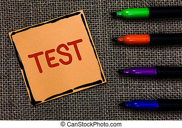 Word writing text Test. Business concept for Academic systemic procedure assess reliability durability proficiency Marker pens art board small pitch paper lovely love ideas mat black shadow.