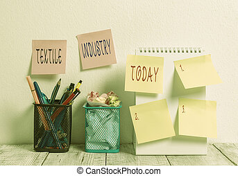 Word writing text Textile Industry. Business concept for production and distribution of yarn cloth and clothing 6 Sticky Notes on Wall Open Spiral Notebook 2 Pencil Pots on Work Desk.