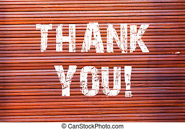 Word writing text Thank You. Business concept for polite expression used when acknowledging gift service compliment Brick Wall art like Graffiti motivational call written on the wall.