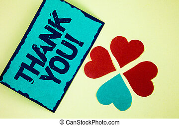 Word writing text Thank You Motivational Call. Business concept for Appreciation greeting Acknowledgment Gratitude written on Sticky Note paper on plain background Paper Love Hearts next to it.