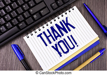 Word writing text Thank You Motivational Call. Business concept for Appreciation greeting Acknowledgment Gratitude written on Notepad on wooden grey background Pens and Black Keyboard next to it.