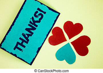 Word writing text Thanks Motivational Call. Business concept for Appreciation greeting Acknowledgment Gratitude written on Sticky Note paper on plain background Paper Love Hearts next to it.