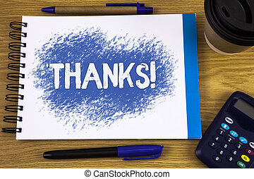 Word writing text Thanks Motivational Call. Business concept for Appreciation greeting Acknowledgment Gratitude written on Notepad on wooden background Pen Cup and Calculator next to it.
