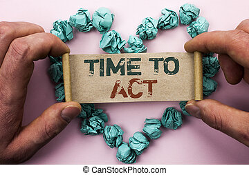 Word writing text Time To Act. Business concept for Action Moment Strategy Deadline Perform Start Effort Acting written on Cardboard Paper Holding by man plain background on Heart Paper Balls.