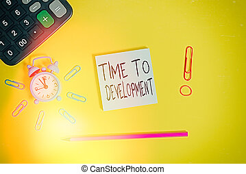Word writing text Time To Development. Business concept for a length of time during which a company grows or develop Alarm clock calculator clips rubber band pencil notepad colored background.