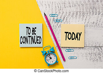 Word writing text To Be Continued. Business concept for indicate that the story continues in the next episode Notepads marker pen colored paper sheet alarm clock wooden background.
