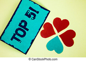 Word writing text Top 5 Motivational Call. Business concept for The best ones Winners Most Popular Bestsellers written on Sticky Note paper on plain background Paper Love Hearts next to it.