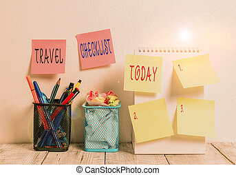 Word writing text Travel Checklist. Business concept for a list of things to be checked or done for the planned trip 6 Sticky Notes on Wall Open Spiral Notebook 2 Pencil Pots on Work Desk.